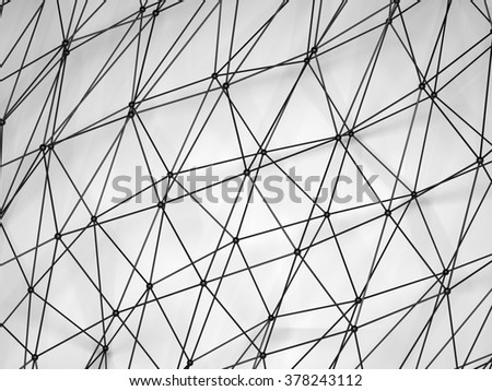 Abstract black shining 3d digital molecular mesh structure over white background with soft shadow