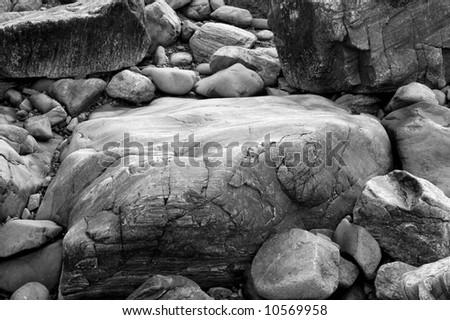 Abstract Black & White image of large granite rocks - stock photo