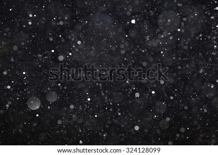 Abstract black white snow texture on black background for overlay