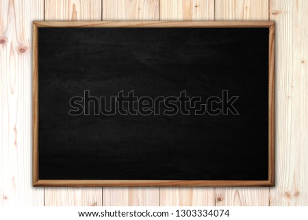 Abstract blackboard or chalkboard with frame on wooden background. empty space for add text. #1303334074