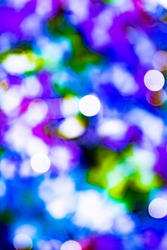 Abstract blinking lights background with bokeh defocused lights. Valentine's day, party, warm, joy, Christmas background.