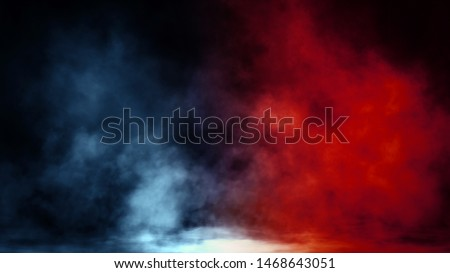 Abstract blue and red smoke steam moves on a black background . The concept of aromatherapy.