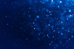 Abstract Blue bokeh defocus glitter blur background.