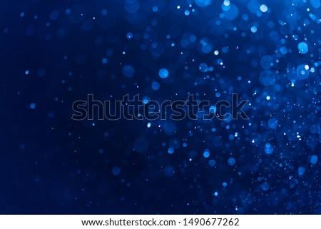 Abstract Blue bokeh defocus glitter blur background.