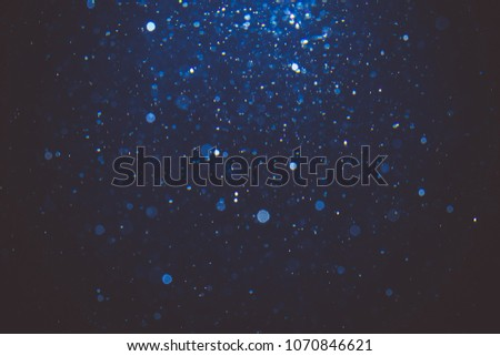 Abstract blue bokeh with black background