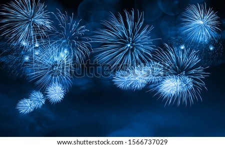 Abstract blue color firework background with free space for text.  Variety of colors Mix Fireworks or firecracker burst collections
