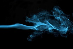 Abstract blue colored smoke isolated on black
