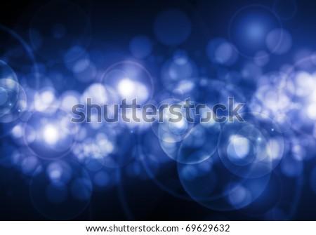 Abstract blue defocused lights on black background