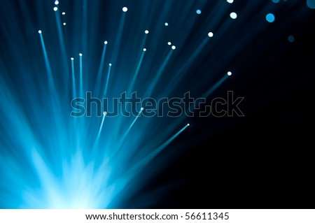 Abstract blue fibre optic strands.
