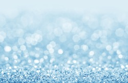 Abstract blue glitter background. Shiny glitter bokeh christmas background.
