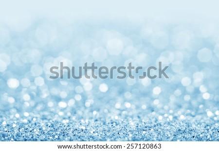 Abstract blue glitter background. Shiny glitter bokeh christmas background.