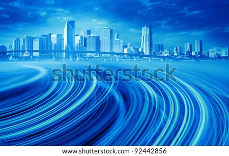 Abstract blue Illustration of an urban highway going to the modern city downtown . Background image of Miami Florida is from my collection.