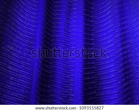 Abstract. blue mesh fabric texture. Macro perspective, blue sailcloth fabric #1093155827