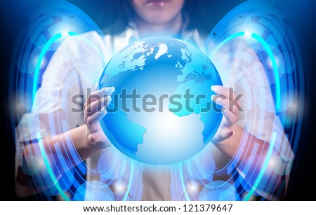 Abstract, blue planet earth in hands of girl.