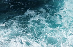 Abstract blue sea water with white wave for background