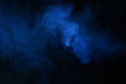 Abstract blue smoke on a dark background. Blue smoke background