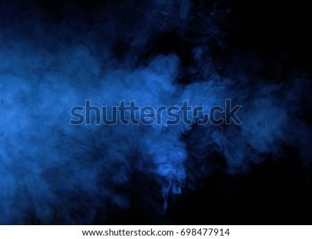 Abstract blue smoke on a dark background. Blue smoke background #698477914