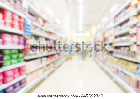 Abstract blur and bokeh supermarket and discount store interior for background