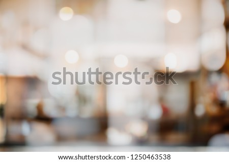 Abstract blur and defocused interior coffee shop or cafe for background. #1250463538