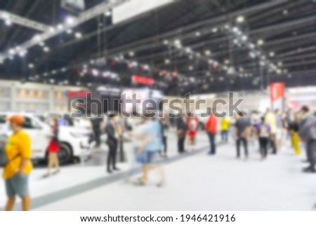 Abstract blur and defocused visitors and cars at international motorshow in Bangkok, Thailand.