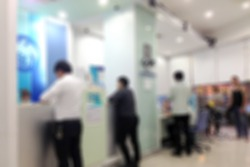 Abstract blur background of people crowd in bank counter, urban lifestyle concept.