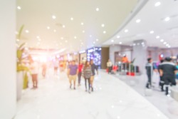 Abstract blur beautiful modern luxury shopping mall and retails store interior for background. color filter people walking in shopping mall. department store indoor. shopping mall.vacation weekend day