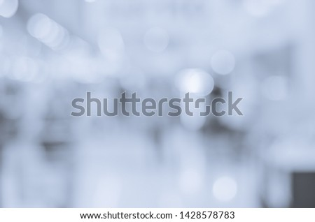 abstract blur bokeh background blue tone indoor in the shopping mall with many people.