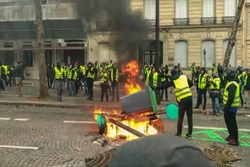 Abstract, blur, bokeh background, defocusing - image for the background. Street riots in Paris, France
