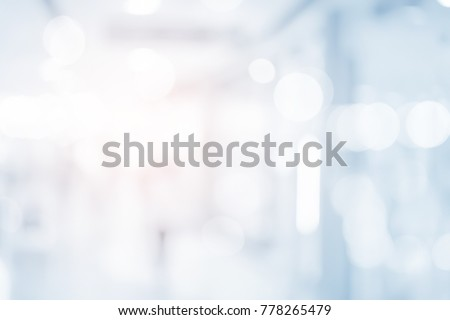 abstract blur contemporary office interior blue background with orange shine light effect concept