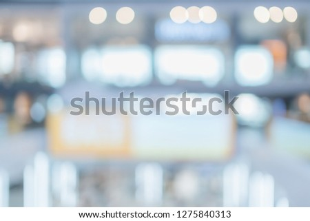 abstract blur defocus background of mall department store with walkway and people shopping
