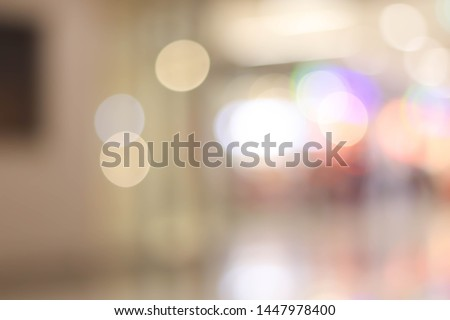 Abstract blur department store with shopping mall interior for background.