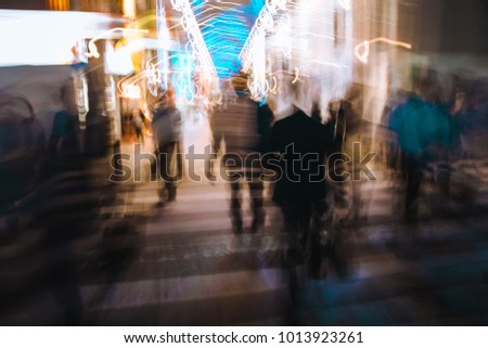 Abstract blur figures across the street - Shutterstock ID 1013923261