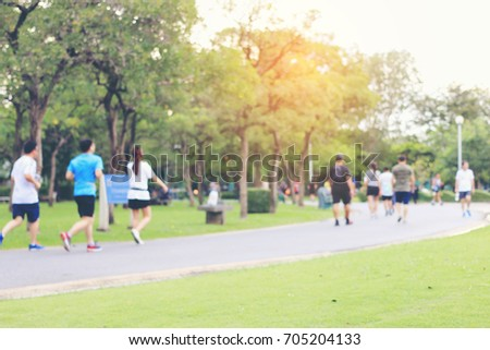 abstract blur focus of people activities in park with bokeh, spring and summer season , Urban outdoor workout. Healthy lifestyle concept. Bangkok Thailand.