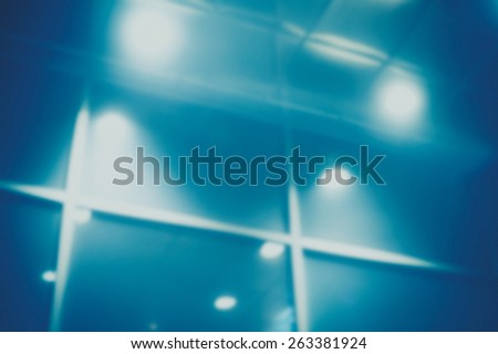 Abstract blur glass wall lights of an office building