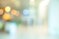 abstract blur image background of shopping mall with light bokeh and flare light bulb