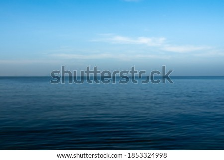 Abstract blur image of blue sea and clouds on sky background usage. Seascape with sea horizon and almost clear deep blue sky. Wallpaper, Background. Foto stock ©