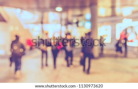 Abstract blur image of Business people walking at  modern hallway with bokeh for background usage . (vintage tone)