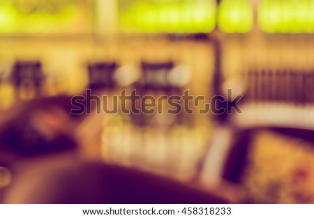 Abstract blur image of Coffee bar or Retro restaurant for background usage . (vintage tone) #458318233