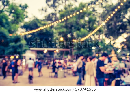 abstract blur image of  day festival  in garden with bokeh for background usage . (vintage tone)