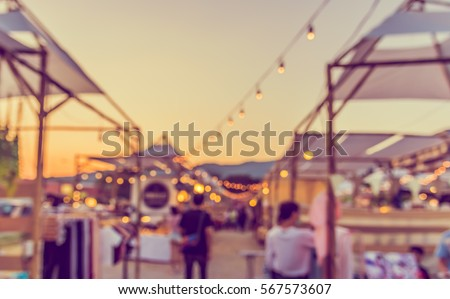 abstract blur image of food stall at day festival for background usage. (vintage tone) #567573607