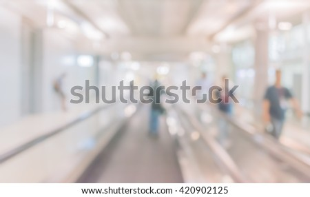 abstract blur image of long corridor in airport with people for background usage . #420902125