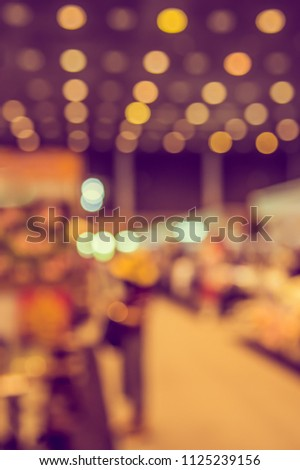 Abstract blur image of People walking at Shopping mall or Exhibition hall with bokeh for background usage . (vintage tone) #1125239156
