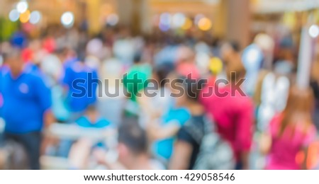 Abstract blur image of  people walking in shopping mall for background usage. #429058546