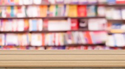 abstract blur inside library bookshelf background with contemporary wood perspective table for show , promote , advertisement of goods and product on display concept
