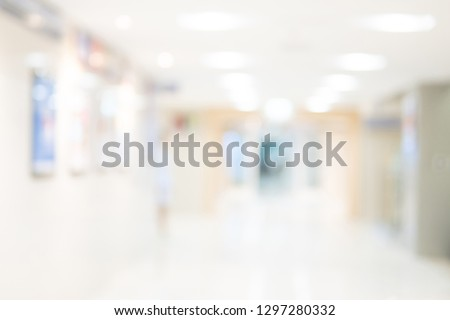 Abstract blur luxury hospital corridor. Blur clinic interior background with defocused effect. Healthcare and medical concept