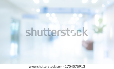Abstract blur luxury hospital hall. Blur clinic corridor interior background with defocused effect. Healthcare and medical concept