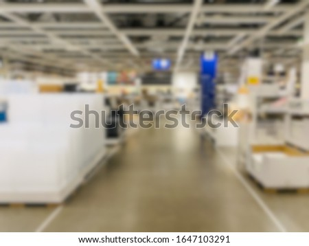 Abstract blur of indoor retail shop with nobody inside.