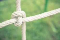 Abstract blur of knot rope from kid toy in park playground - Vintage filter