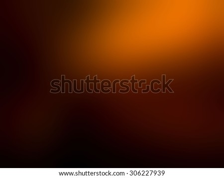 Abstract blur of orange black background