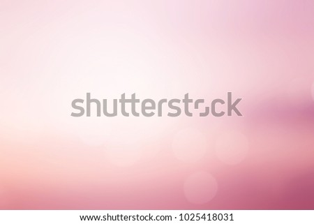 abstract blur of pastel beautiful sunrise pink color sky warm tone background with shining light flare and bokeh for design as banner,slide show or others  #1025418031